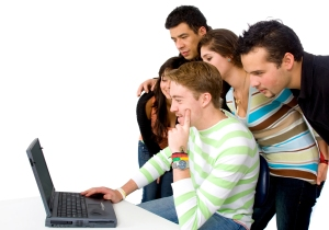 group of people on a laptop